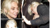 Lindsay Lohan Stumbles on First Night of Freedom