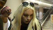 Lindsay Lohan Returns from Hawaii -- Parties at Jay-Z Concert
