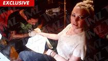 Lindsay Lohan -- The Girl with a New Wrist Tattoo [PHOTO]