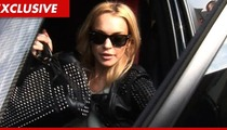 Lindsay Lohan Sued by Paparazzo Over Car Accident