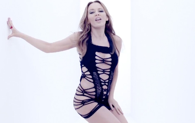 Whoa! Kylie Minogue, 43, Wears Barely-There Dress In New Video