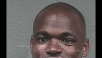 Adrian Peterson -- The Smiley Mug Shot [UPDATE]