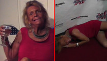 Tanning Mom -- A Wasted, Stumbling, Panty-Flashing Train Wreck [VIDEO]