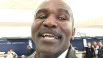 Evander Holyfield's Assistant Sued Over Botched Auction