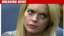 Lindsay Surrenders -- Cuffed and Headed for Jail