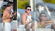 Simon Cowell -- The Moobs Cover-Up!
