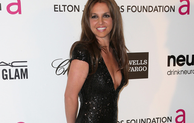 Britney Spears Goes Brunette, Parties with Elton John