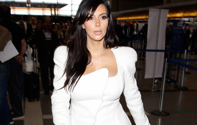 Kim Kardashian Takes Baby Bump to Paris with Kanye West