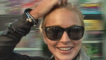 Lindsay Lohan Settles Beef With Paparazzo ... Over Squashed Foot