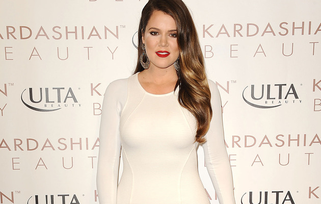 Khloe Kardashian Is White Hot In Curve-Hugging Mini