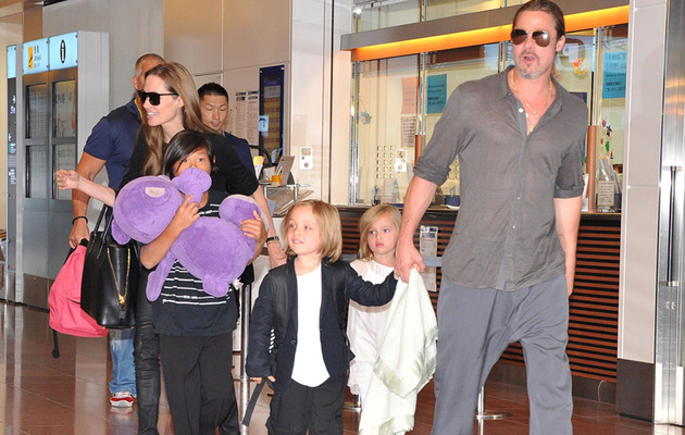 Brad Pitt & Angelina Jolie Bring Their Brood to Tokyo