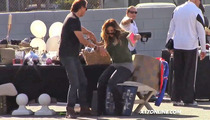 Kim Kardashian -- Falls On Her Ass for a Pile of Old Crap