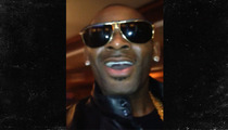 R. Kelly Slums It With Cell Phone Music Video