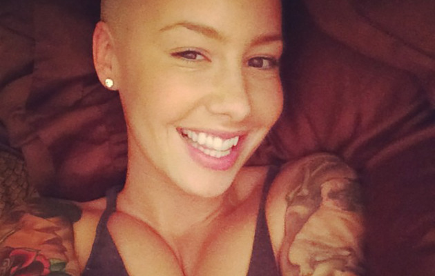 Amber Rose Gets New Gold Grill -- See the Picture!
