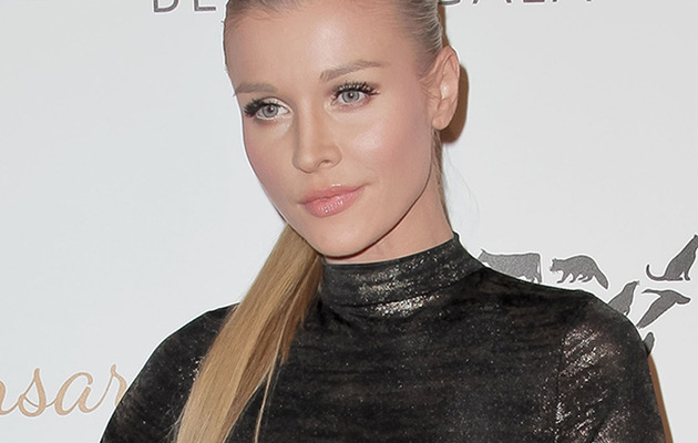 Joanna Krupa Has Wardrobe Malfunction at Humane Society Event