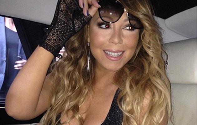 Mariah Carey Flaunts Major Cleavage in Long Black Gown