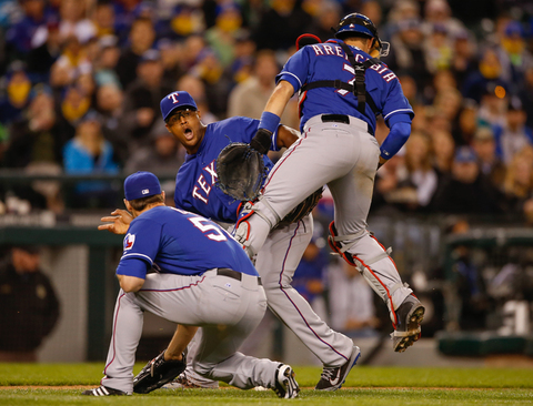 Adrian Beltre of the Texas Rangers collides with catcher J.P. Arencibia while trying to field a sacrifice bunt by Stefen Romero