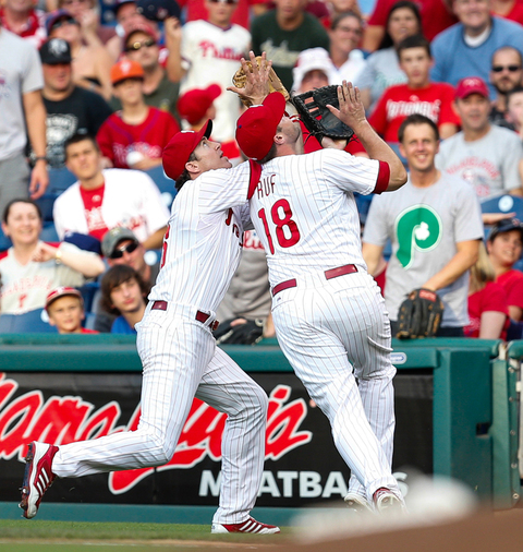 Chase Utley and Darin Ruf of the Philadelphia Phillies collide attempting to catch a foul ball