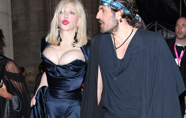 Courtney Love Almost Pops Out of Her Dress at Life Ball