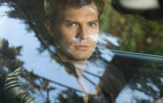 "Jamie Dornan Smoulders In New Photo from ""Fifty Shades of Grey"""