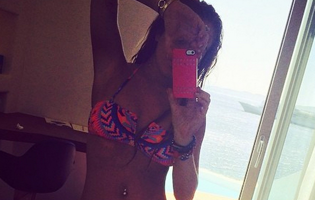 Lindsay Lohan Puts Impressive Beach Bod on Display In Bikini