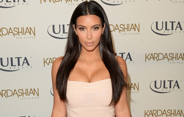 Kim Kardashian Flaunts Major Cleavage in Sexy Strapless Dress