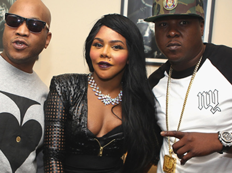 Lil' Kim Flaunts Post-Baby Bod (And Lots of Cleavage) During Surprise Show