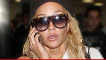 Amanda Bynes Makes it Rain in Hotel Lobby