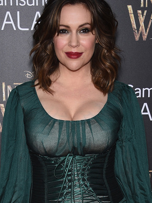 "Alyssa Milano Flaunts Major Cleavage In Witchy Ensemble at ""Into the Woods"" Premiere"