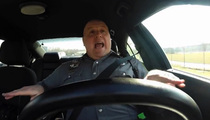 Cop Singing 'Shake It Off' -- Dash Cam Footage is Fake ... But It's Still Awesome!