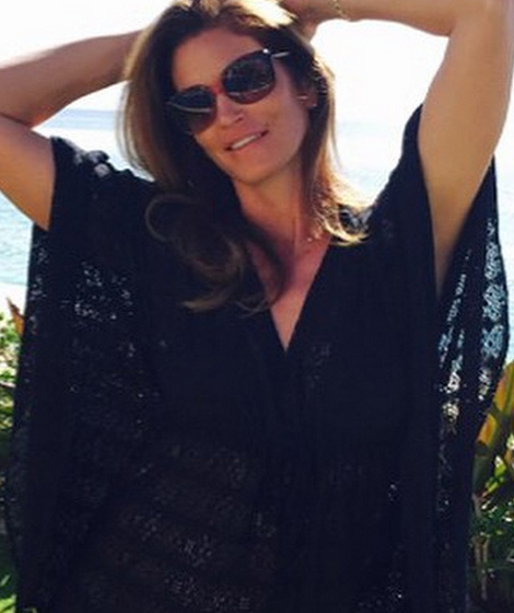 Cindy Crawford Looks Stunning While Lounging By Pool After
