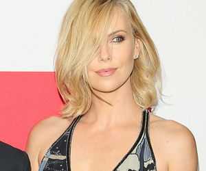 "Charlize Theron Stuns at ""The Gunman"" Premiere With Sean Penn -- See Her Sexy…"