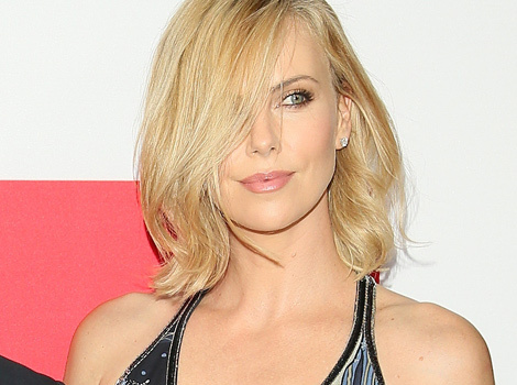 "Charlize Theron Stuns at ""The Gunman"" Premiere With Sean Penn -- See Her Sexy Look!"