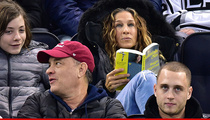 Sarah Jessica Parker -- Bored Off Her Ice ... Reads Book During NHL Game