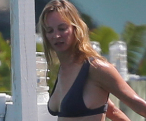 Uma Thurman Shows Off Fit Physique in Black Bikini!