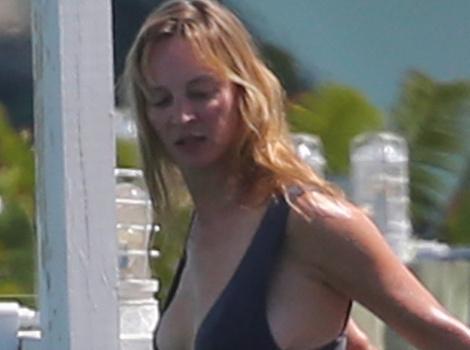 Uma Thurman Shows Off Fit Physique in Black Bikini!