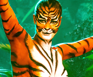 "Rebecca Romijn Goes Naked (As a Tiger!) For Super Sexy ""Skin Wars"" Teaser"