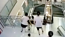Heroic Woman Saves Her Son's Life After Freak Escalator Accident (VIDEO)