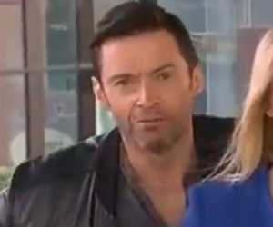 See Hugh Jackman & Sam Smith Photobomb Live News Segments!