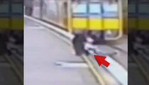 Near Disaster -- Lady Pulls Kid Off Tracks Before Train Hits (Video)