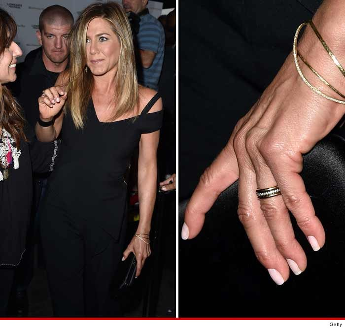 jennifer aniston is back from bora bora proudly displaying the symbol of marriage - Jennifer Aniston Wedding Ring