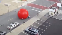 Crazy Video -- HUGE Runaway Ball Through City Streets