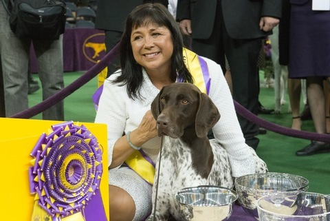 <span>Handler Valerie Nunes-Atkinson embraces German shorthaired pointer named C.J. after he won 'Best in Show' of the 140th Annual Westminster Kennel Club Dog Show at Madison Square Garden in New York on February 16, 2016.</span>