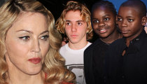 Madonna Sues -- My Kids Can Be Home Alone If I Want