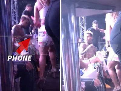 Chris Brown -- Tosses Girl & Her Phone from VIP (VIDEO)