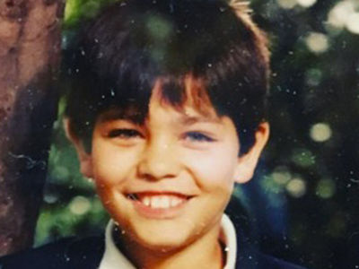 Guess Who This Smiling Stud Turned Into!