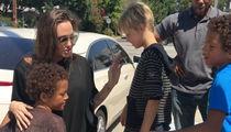Angelina Jolie -- Help$ Kids Unload 8 Foot Tall Teddy Bear! (VIDEO + PHOTOS)