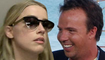 Amber Heard -- Drops Suit Against Doug Stanhope
