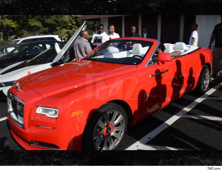 Gucci Mane in his red Rolls-Royce Phantom Drophead Coupé luxury car