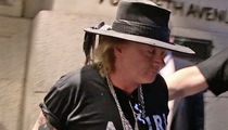 Axl Rose -- Settles Lawsuit With Loyal Roadie